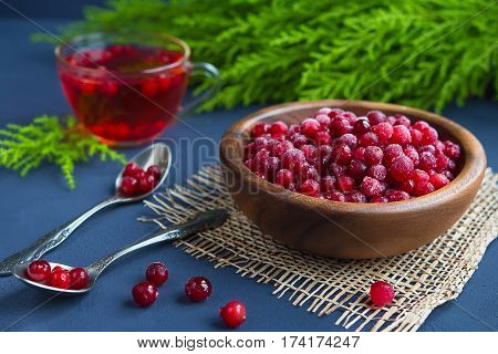 Cranberries and cranberry juice on a dark background