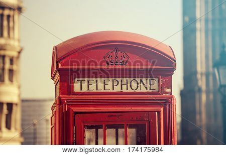 Red telephone booth and Big Ben in London, England, the UK. The symbols of London. Retro styled photo