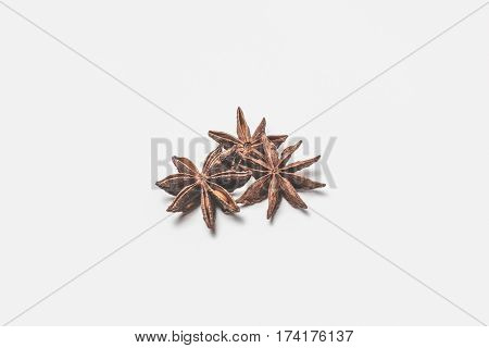group of star anise spice fruits and seeds isolated on white background closeup