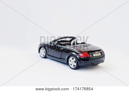 Hai, Ukraine - March 1, 2017: Mini Copy Of Red Toy Car Audi Tt Convertible Isolated On White Backgro