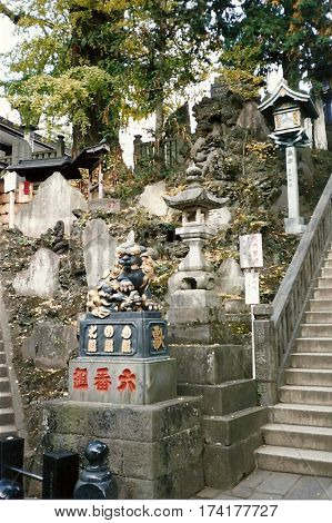 NARITA, CHIBA / JAPAN - CIRCA NOVEMBER, 1987: A sculpture of a lion on a pedestal in the Narita-san Shinshō-ji Shingon Buddhist temple.