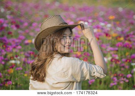 Pretty girl slender brunette in a safari dressPretty girl in a safari dress at flower garden.