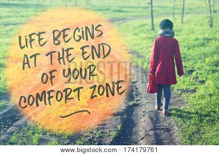 slogan about life begins outside comfort zone printed on image with girl in red coat going far away by dirty country road