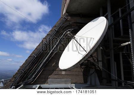 Satellite Dish On Telecommunication Tower On Sunny Day
