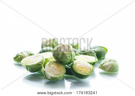 raw Brussels sprouts on a wooden table