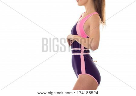 body beautiful slim girl in body swimsuit which stands sideways and takes the waist Ribbon isolated on white background
