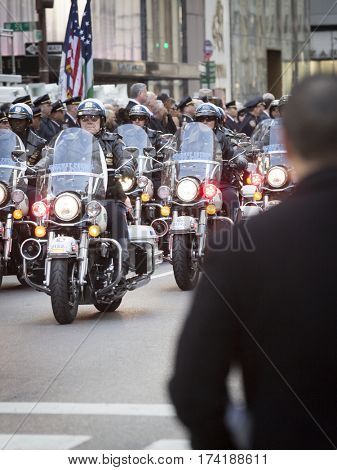 NEW YORK - JAN 13 2017: NYPD Det. Steven McDonald funeral procession and service at St Patricks Cathedral, 5th Avenue, Manhattan - Motorcycles of the New York Highway Patrol escort arrive.