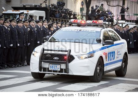 NEW YORK - JAN 13 2017: NYPD Det. Steven McDonald funeral procession and service at St Patricks Cathedral, 5th Avenue, Manhattan - Lead car of the New York Highway Patrol escort arrives.