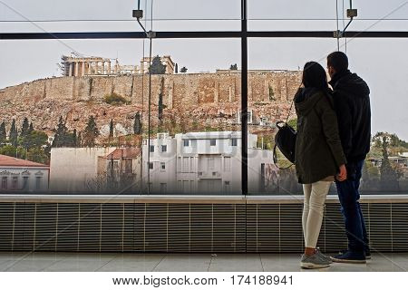 Young couple seeing the Acropolis in Athens.