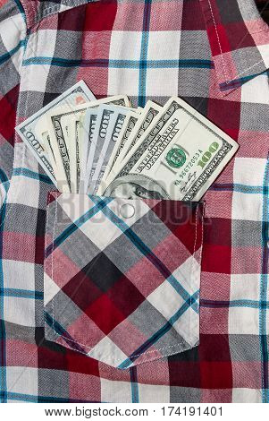 hundred american dollars in the pocket of shirt