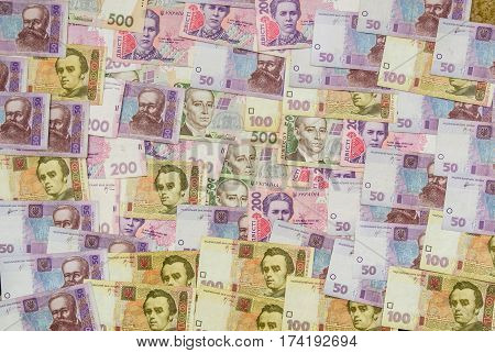 different ukrainian banknotes background close-up 100 200 500