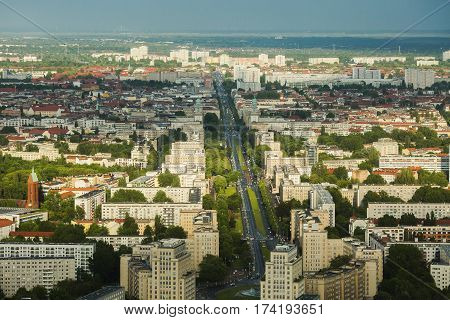 Travel to Germany. View of the houses and streets of Berlin with a bird's-eye view. Overcast sky. Light from the sun on the houses. Residential houses in megalopolis. Berlin megapolis. European megalopolis city