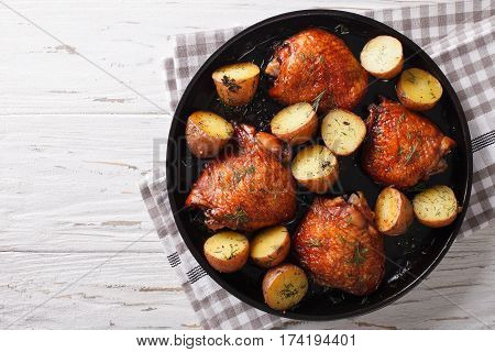 Roast Chicken Thighs And Baby Potatoes With Maple Syrup Closeup. Horizontal Top View
