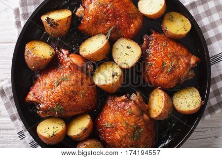Maple Chicken Thighs And Baby Potatoes Close-up. Horizontal Top View