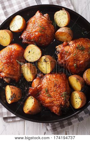 Maple Chicken Thighs And Baby Potatoes Close-up. Vertical Top View