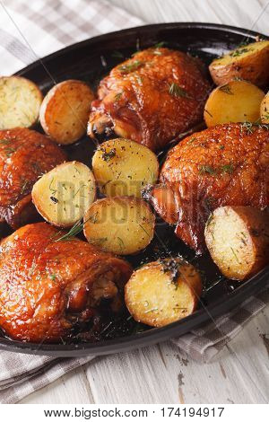 Roast Chicken Thighs And Baby Potatoes With Maple Syrup Closeup. Vertical
