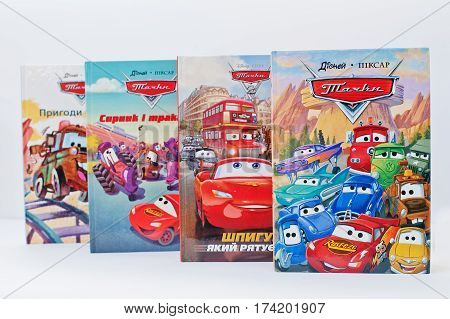 Hai, Ukraine - February 28, 2017: Animated Disney Movies Cartoon Production Book Sets Cars On White