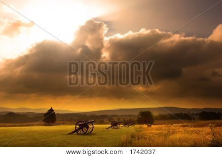 Sunrise over a row of cannon at the Antietam Civil War Battlefield at Sharpsburg Maryland USA poster
