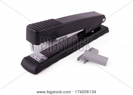 Office stapler for a paper fastening black with metal inserts on a white background white background with soft shadow. Photo with clipping path
