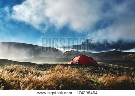 Travel to Iceland. Beautiful Icelandic landscape with mountains, sky and clouds. Trekking in national park Landmannalaugar. Morning in Camping . Tents and hikers in the camping. Travel concept. poster