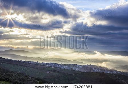 Stunning overview of Guadalupe village during a foggy sunrise Caceres Spain