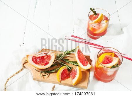 Grapefruit and rosemary gin cocktail refreshing drink with ice.