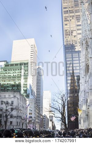 NEW YORK - JAN 13 2017: NYPD Det. Steven McDonald funeral procession and service at St Patricks Cathedral, 5th Avenue, Manhattan - NYPD helicopter fly over 5th Avenue to pay tribute.