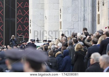 NEW YORK - JAN 13 2017: NYPD Det. Steven McDonald funeral procession and service at St Patricks Cathedral, 5th Ave, Manhattan - Flag-draped coffin carried past hundreds of people into the cathedral.