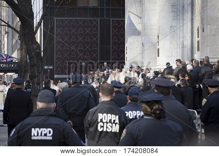 NEW YORK - JAN 13 2017: NYPD Det. Steven McDonald funeral procession and service at St Patricks Cathedral, 5th Avenue, Manhattan - Clergy and attendees exit St Patricks Cathedral.
