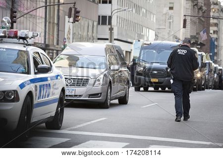 NEW YORK - JAN 13 2017: NYPD Det. Steven McDonald funeral procession and service at St Patricks Cathedral, 5th Avenue, Manhattan - Hearse arrives at St Patricks Cathedral.