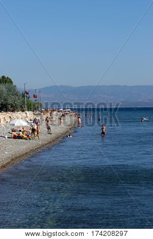 Altinoluk, Turkey - August 22, 2009: Altinoluk beach and sunbathing people inn Balikesir, Turkey