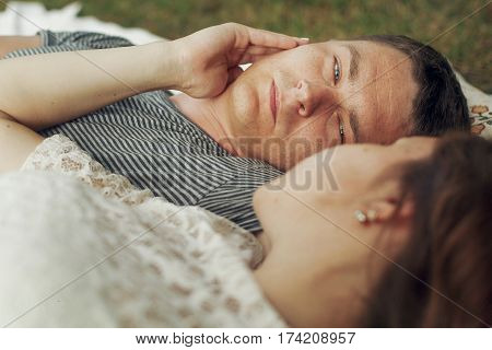 Sleepy, Caring Husband Looking At Beautiful Pregnant Wife, Waiting For Baby