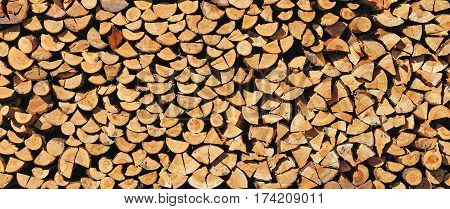 Pile of wood cut for fireplace. Natural background.