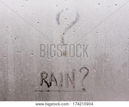 The Inscription On The Sweaty Window From Humidity - Rain English Capital Letters, The Window Is Rai
