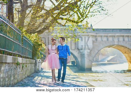 Romantic Couple On The Seine Embankment In Paris