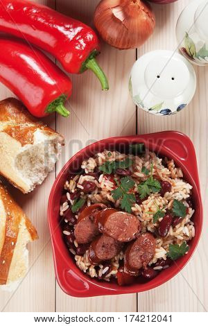 Rice and beans, staple food meal with sausage slices