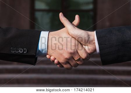 Business agreement. Business handshake on background Bank. Business shake hands with each other. Friendship partners in business. Business concept. Business friend. Business people