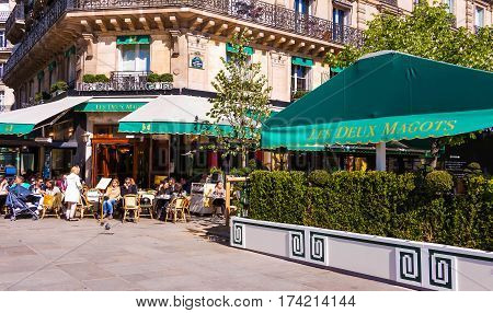 Paris France-May 05 2016: the famous cafe Les deux Magots located in Saint Germain des Pres area of Paris.It has been frequented by Ernest Hemingway Pablo PicassoAlbert Camus James Joyce...