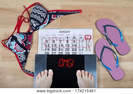 Digital scales with female feet on them and sign