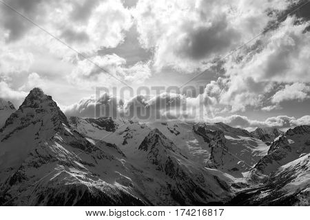 Black And White View On Winter Snow Mountains And Cloud Sky In Evening