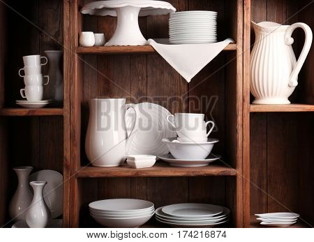 Wooden shelves with white rustic dinnerware