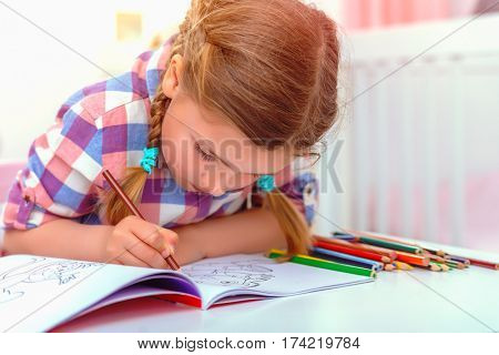 creative clever smart child at home while preparing for school