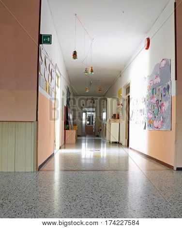 Inside Of A Long Corridor Of The Kindergarten With Drawings On T