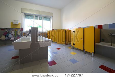 Inside A School Bathroom With Small Sinks