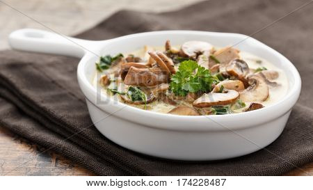 Mushrooms with cream sauce and fresh herbs.