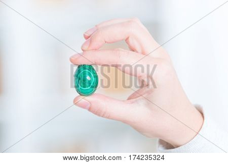Malachite semi preciouse gemstone in hand