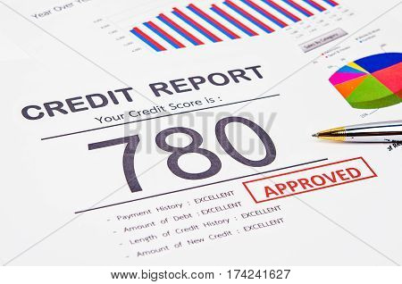 Credit score report and approved with pen on business report document.