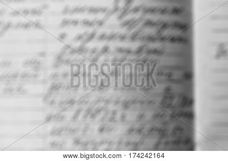 The old handwritten letter the text of the handle for background unfocused