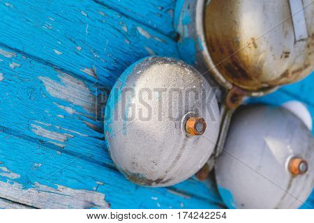 Classic alarm bell on a blue wooden wall in the winter on the outside. Close up