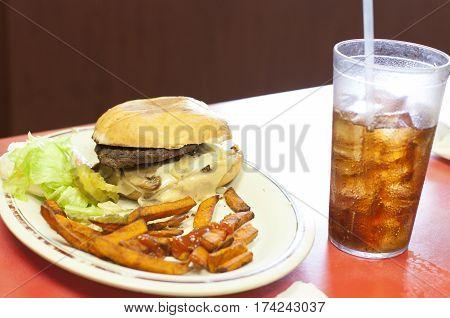 Burger And Cajun Fries